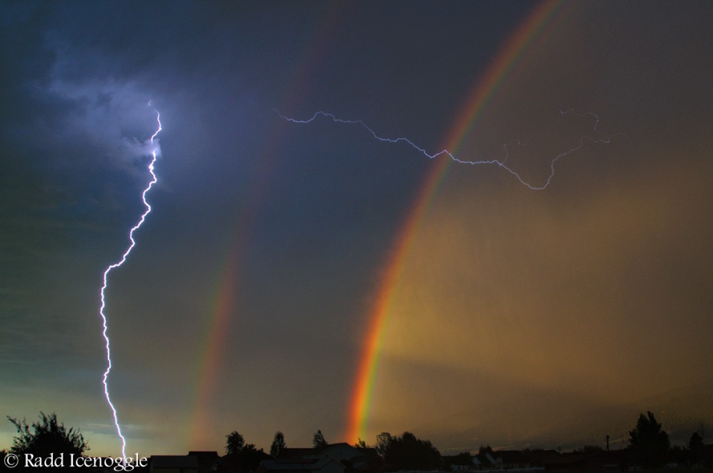 Double rainbow and lightning at dawn over Lolo