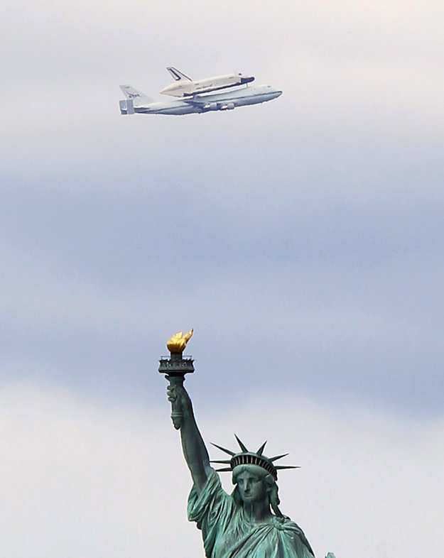 Space Ship Flying Over Statue of Liberty