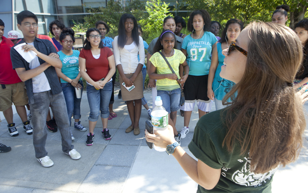 A tour guide speaks to prospective students